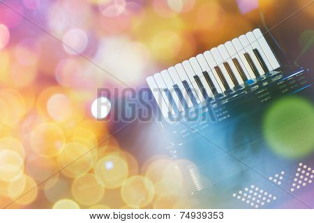 Accordion with color bokeh light in background