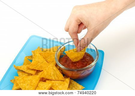 Dipping Tortilla Chips With Salsa Sauce In Dish On White Background