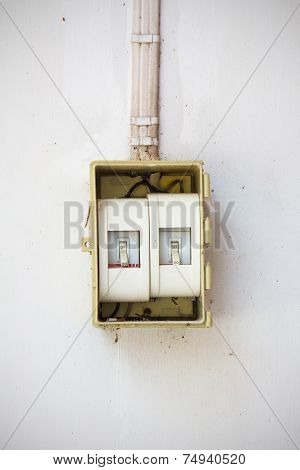 Old Light Switch In The Off Position On Dirty And Old Wall