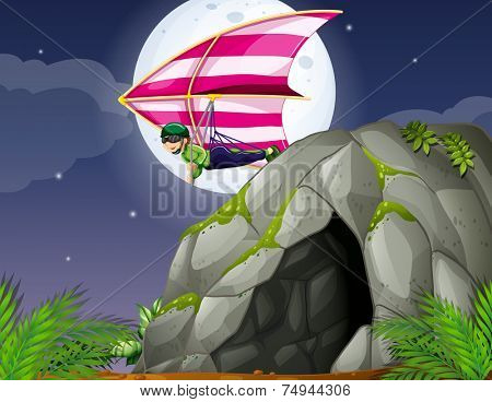 illustration of a man doing hang gliding over a cave