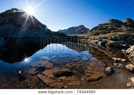 Mont Mars reflected in the Rosso lake in a sunny autumn day. Biella, Piemonte, West italian Alps, Europe.