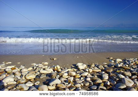 Pebbles on a sandy beach