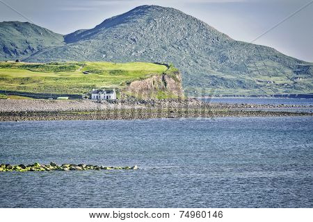 An image of a house at the coast in Ireland