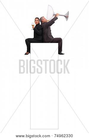 A brazilian couple just enjoying a little sip sat on a banner - Isolated on white background.