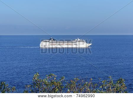 YALTA, CRIMEA, UKRAINE - SEPTEMBER 28, 2009: Cruise liner MSC Opera going from Yalta to Odessa along the Crimean coast. Built in 2004, the liner can carry 1,712 passengers on its 9 decks for guests