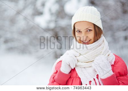 Portrait of pretty girl in casual knitted winterwear looking at camera