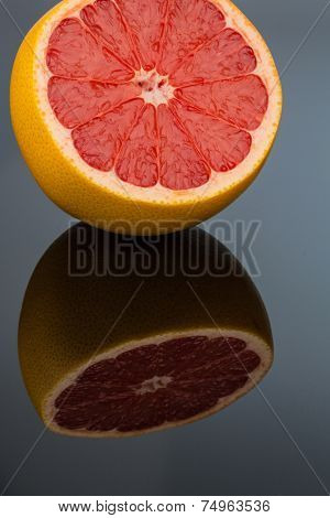 reflection of an orange. symbol photo for healthy vitamins with fresh fruit