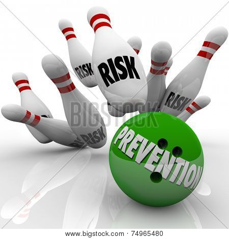 Prevention word on bowling ball striking pins marked Risk to illustrate safety and security in avoiding danger and hazards