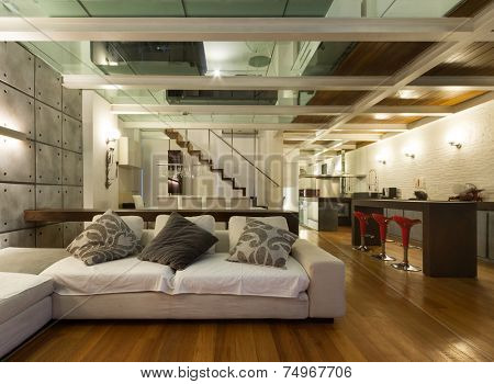 Architecture, wide loft with modern furniture, living room