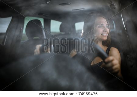 Cute teenager driving her brand new car