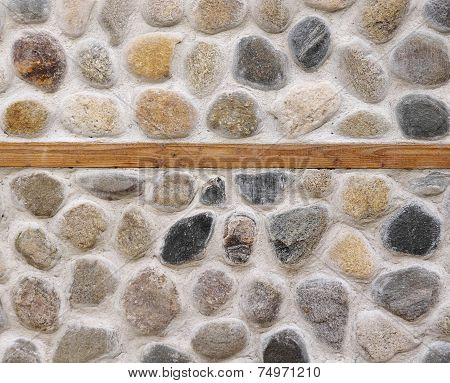 Stone Wall With Wooden Beam Closeup