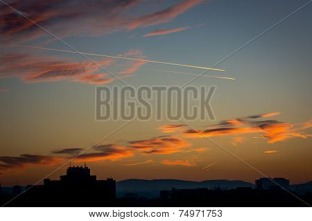 Cloudy Evening Sky With Airplanes And Skyline