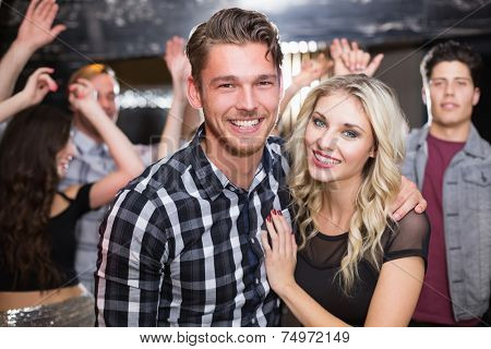 Stylish couple smiling and dancing together at the bar