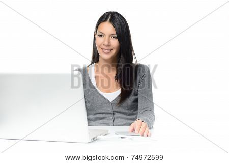Woman Sitting Looking At Her Laptop Computer