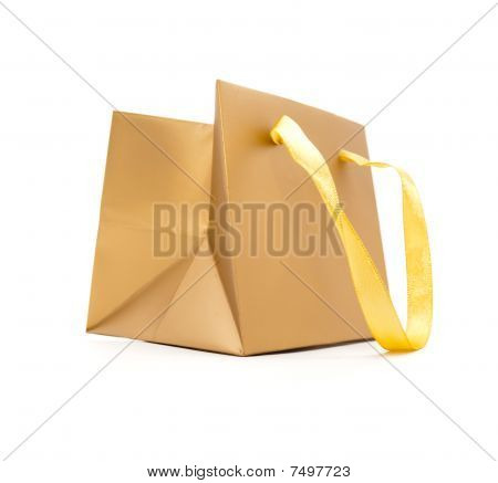 Gift Package Of Gold Colour On A White Background