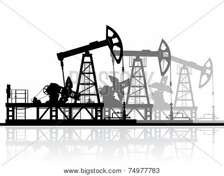 Oil pumps silhouette isolated on white background.