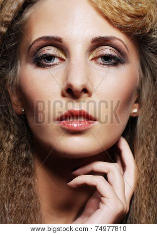 Glamourous woman face with fashion make-up.