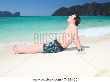 Young  Man Relaxing On The Beach.