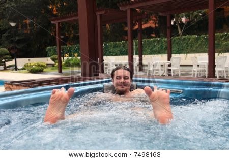 Man Relaxing In Jacuzzi