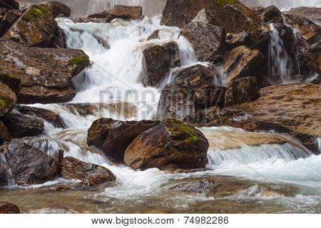 Rough Mountain River With Waterfall