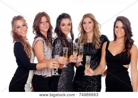 Group of pretty friends toasting with champagne in a celebration during christmas