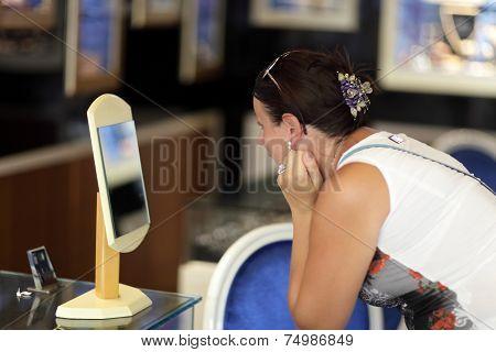 Woman Choosing Earrings