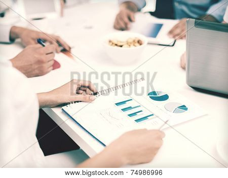 office, school and education concept - business team having discussion in office