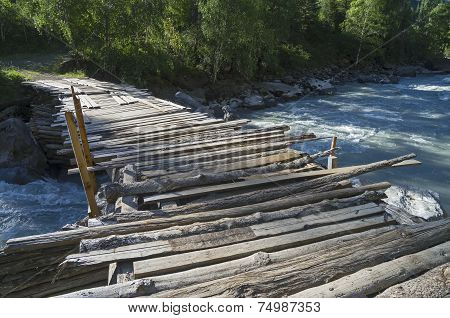 Old Dilapidated Bridge On The Mountain River.