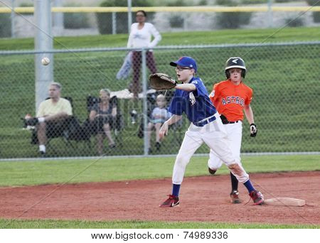 An Infielder Prepares To Force Out A Runner