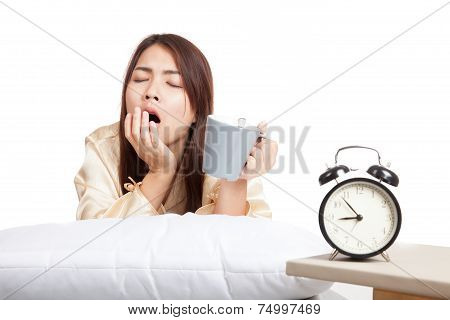 Asian Girl  Wake Up , Yawn With Alarm Clock And  Coffee Cup