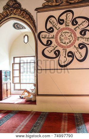 Man Sits In An Alcove Of The Mosque