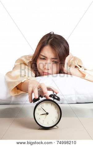 Sleepy Asian Girl With Alarm Clock