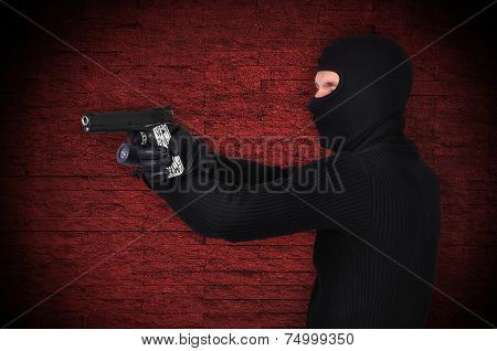 Thug With Gun And Flashlight