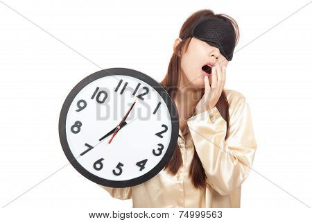 Sleepy Asian Girl Yawn With Eye Mask Hold A Clock