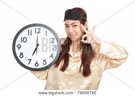 Happy Asian Girl With Eye Mask And Clock Show Ok Sign