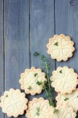 picture of shortbread  - Homemade gluten free shortbread cookies with branches of thyme on old wooden background with copy space viewed from above - JPG
