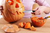 picture of hollow  - Hollowing out pumpkin to prepare halloween lantern - JPG