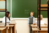 image of epidemic  - School children are learning in the half empty classroom during epidemic of flu - JPG