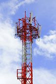 picture of unicity  - Telecommunication tower against the blue sky with multi atenna - JPG