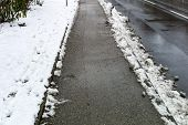 pic of eviction  - snow on sidewalk and street - JPG