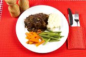 foto of lamb shanks  - Cooked lamb shanks with gravy and vegetables - JPG