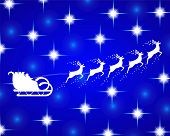 stock photo of sleigh ride  - Santa Claus rides in a sleigh reindeer on blue background - JPG