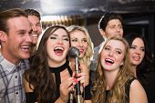 picture of karaoke  - Happy friends singing karaoke together at the bar - JPG