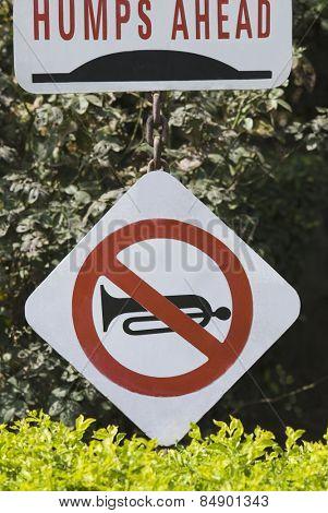 Close-up of No Horn and Humps Ahead road signs, Gurgaon, Haryana, India