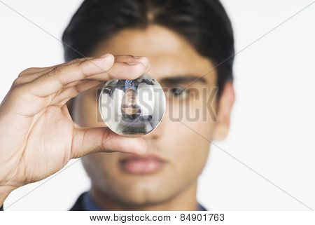 Businessman holding a crystal ball