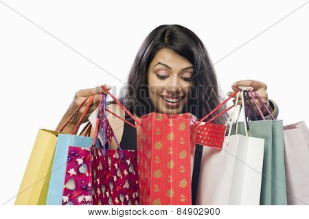 Young woman looking into a shopping bag