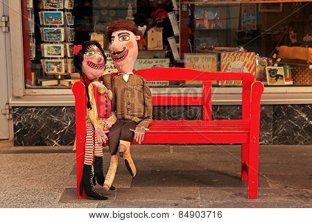 Handmade Lover Dolls On Red Bench, Bratislava , Slovakia.