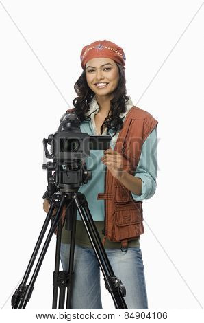 Portrait of a female videographer videographing