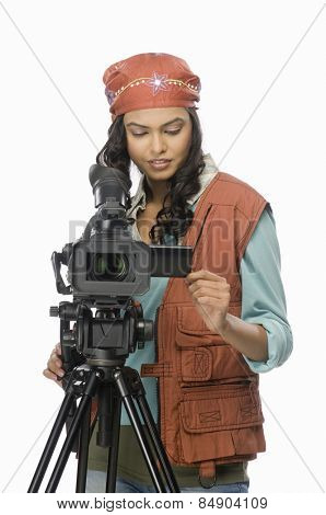 Female videographer videographing