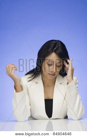 Frustrated businesswoman rubbing her temple